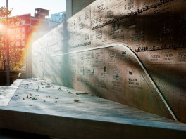 Story wall at Phase One: a large steel 'ghost map' showing the neighborhood's industrial history