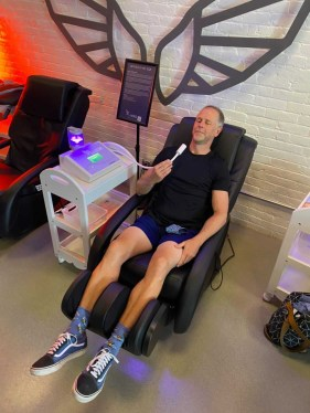 Photo of Brock in a massage chair