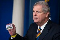 Agriculture Secretary Tom Vilsack holds up a Supplemental Nutrition Assistance Program Electronic Benefits Transfer (SNAP EBT) card during a press briefing at the White House, Wednesday, May 5, 2021, in Washington. (AP Photo/Evan Vucci)