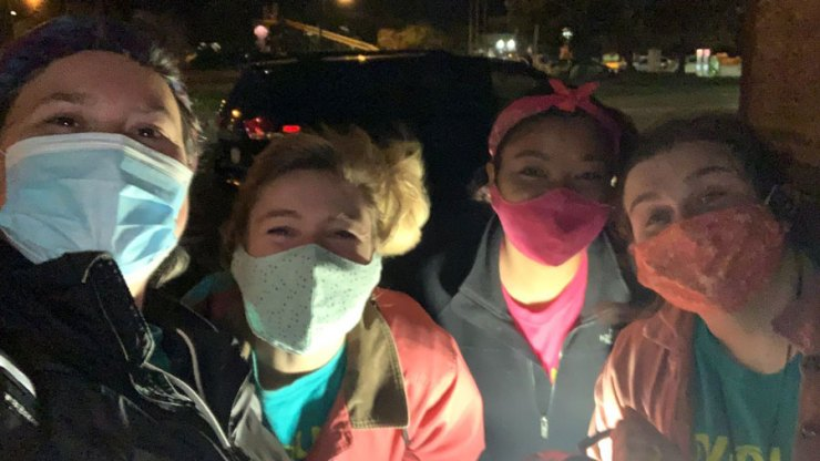 Four Youth Art Team staff members wearing masks outside at the 10-year birthday party!