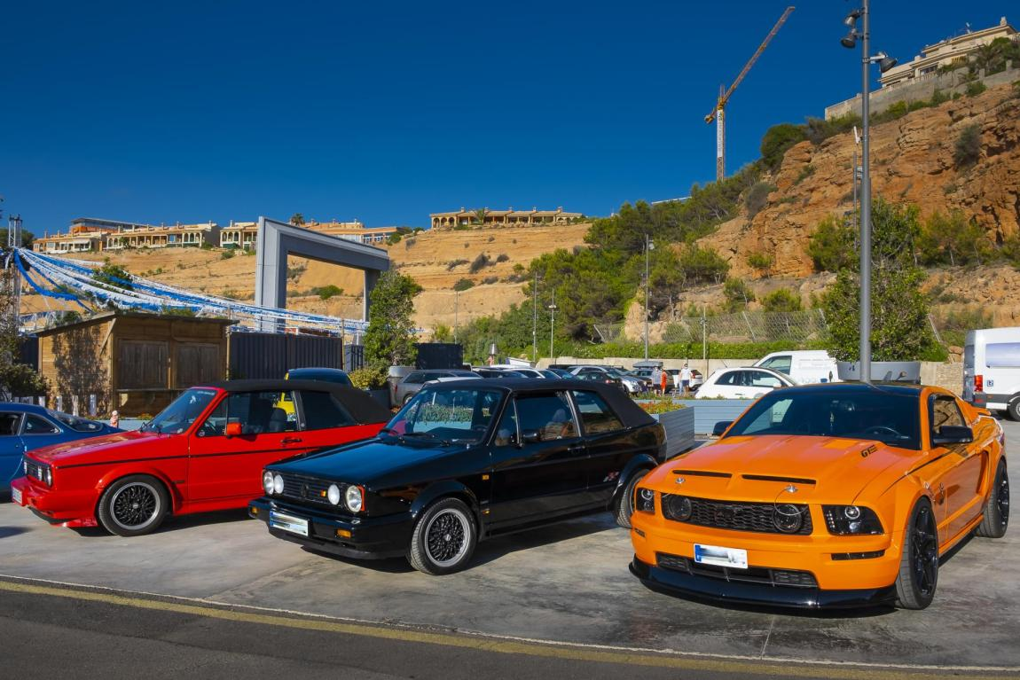 Two very 'clean' Golf GTIs basking in the Mustang's color