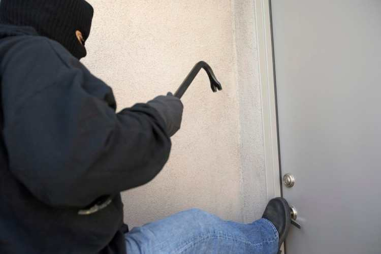 Thief Kicking The Door - front door security tips
