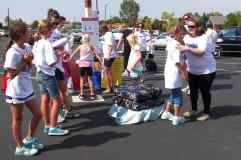 Balance challenge games at the CO walk included the Mattress Walk and Wobble Board.