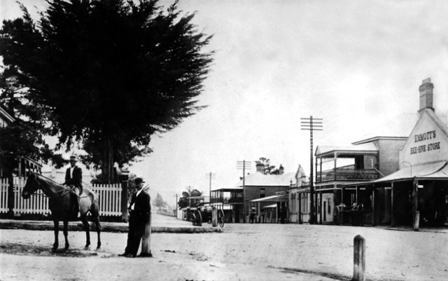 The corner of Queen and Vulcan Street, Moruya in 1888. On one corner stands  Emmott's Store and opposite is the Moruya Courthouse.
