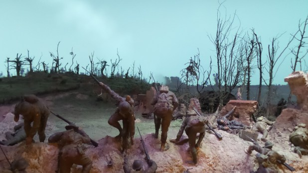 The Mont St Quentin diorama depicts a scene during the 6th Brigade's attack on Mont St Quentin on 1 September 1918. Work began on Mont St Quentin, 1918 in 1920. It was the first diorama completed for the Memorial and previously referred to as Storming of Mont St Quentin