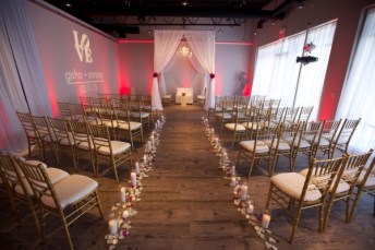 Wedding Ceremony Structure with Red Uplights and Gobo