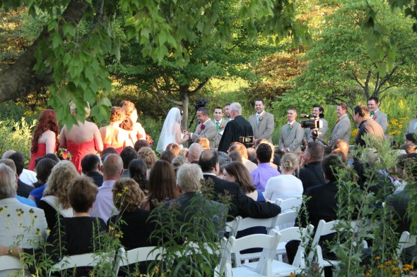 Exchanging rings during an outdoor Wedding in Chicago