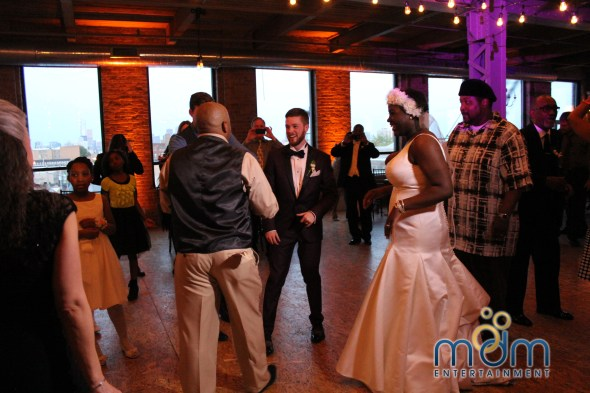 Fun on the dance floor at Kitchen Chicago and City View Lofts Wedding