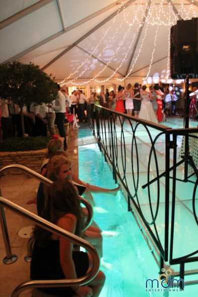 Fun at pool dance floor backyard wedding
