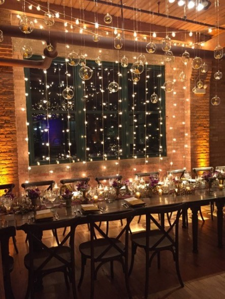 String lights behind head table at Bridgeport Art Center Skyline Loft Wedding
