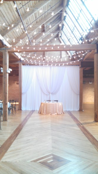 String lights and backdrop at Bridgeport Art Center Skyline Loft