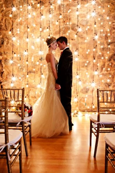 String lights behind wedding ceremony