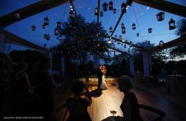 Hanging Lanterns at a Tent Wedding