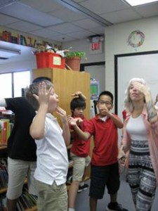 Students practicing movement and storytelling skills with Ms. Amanda Pintore.