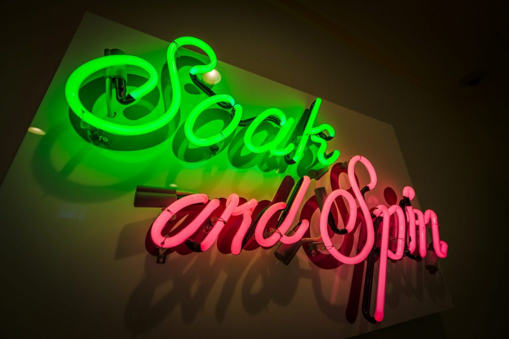 Wash your clothes in style! Fun neon sign designed by Lucy Jones. Photo by John David Helms, www.johndavidhelms.com