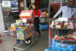 Image from the Economist showing two people leaving a supermarket with full trolleys