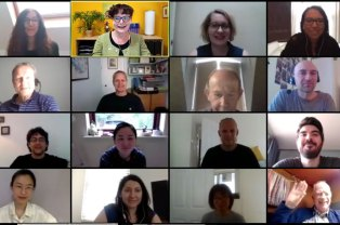 screenshot of a zoom call showing multiple academics waving hello and smiliing