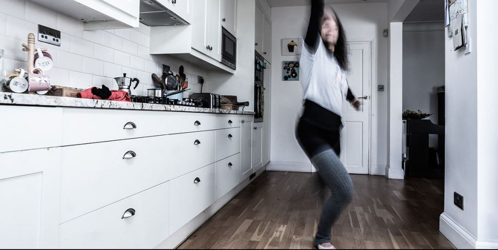 Michela dancing in her kitchen