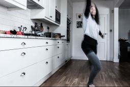Michela dancing in her kitchen