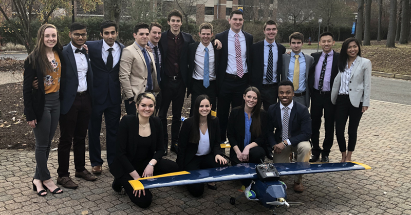 Group of students in front of plane