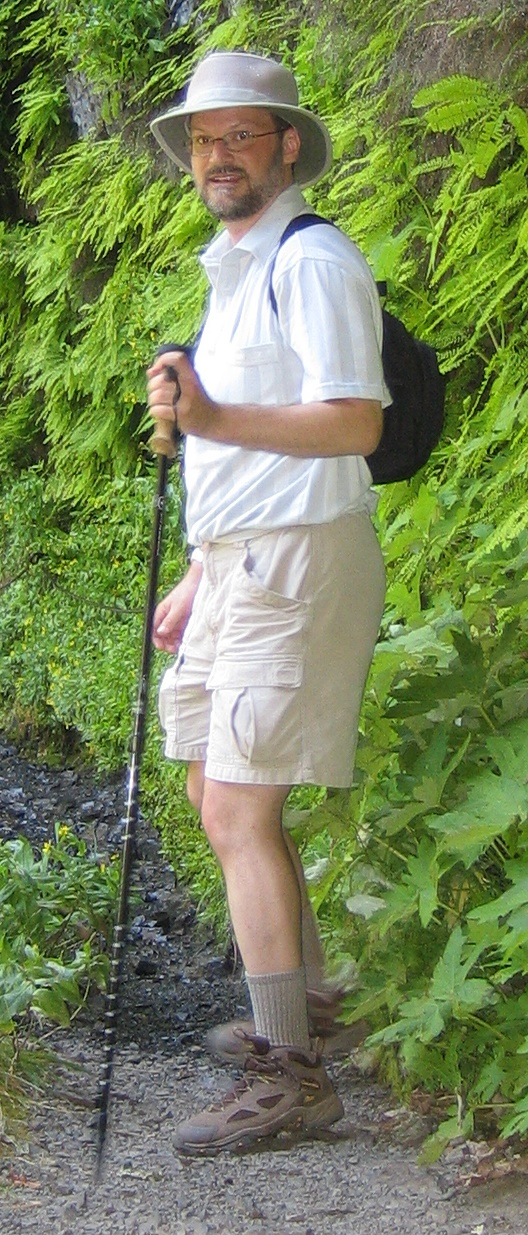 My dayhike attire: Tilley hat, small backpack, cargo shorts, trekking pole, hiking boots and socks.