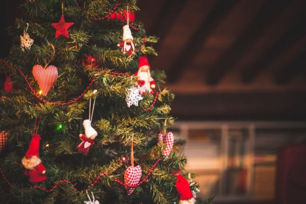 An assortment of Christmas ornaments hanging on a tree