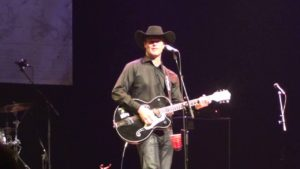 Corb Lund inspires a welcome silence from a rowdy crowd