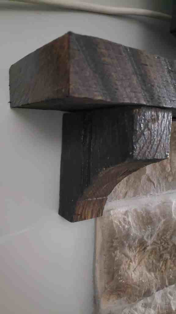 Photo of a mantle pilaster for a reclaimed barn wood mantle blog tutorial