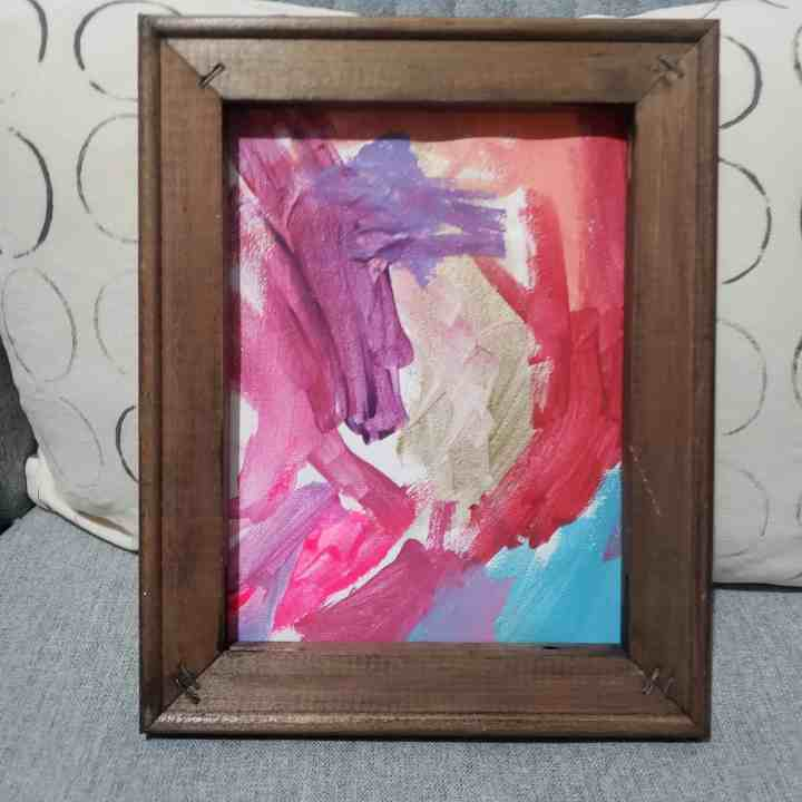 photo of a reversed canvas sign for made by a kid for a summer crafts for kids blog post