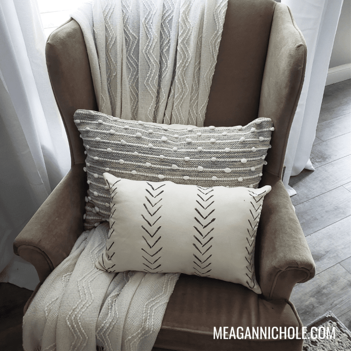 photo of a chair with painted pillows for a cheap and easy diy decor blog post