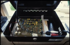 Radio transmitter housed in cash tin, 1999