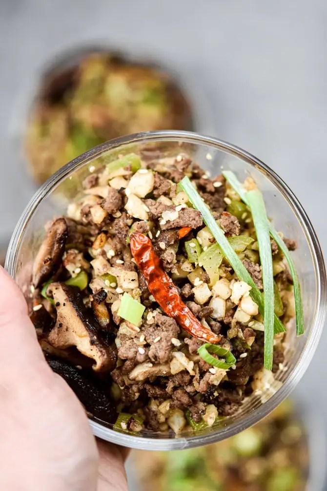 Kung Pao Beef & Cauliflower Rice Bowls close up on light background