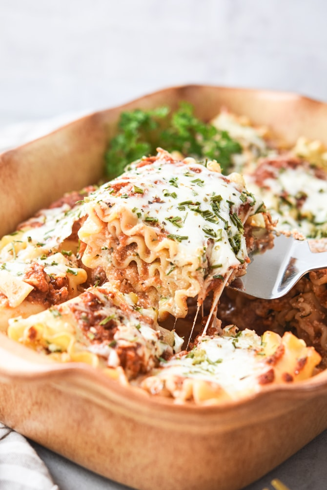 Veggie Loaded Lasagna Roll Ups lifted out of pan