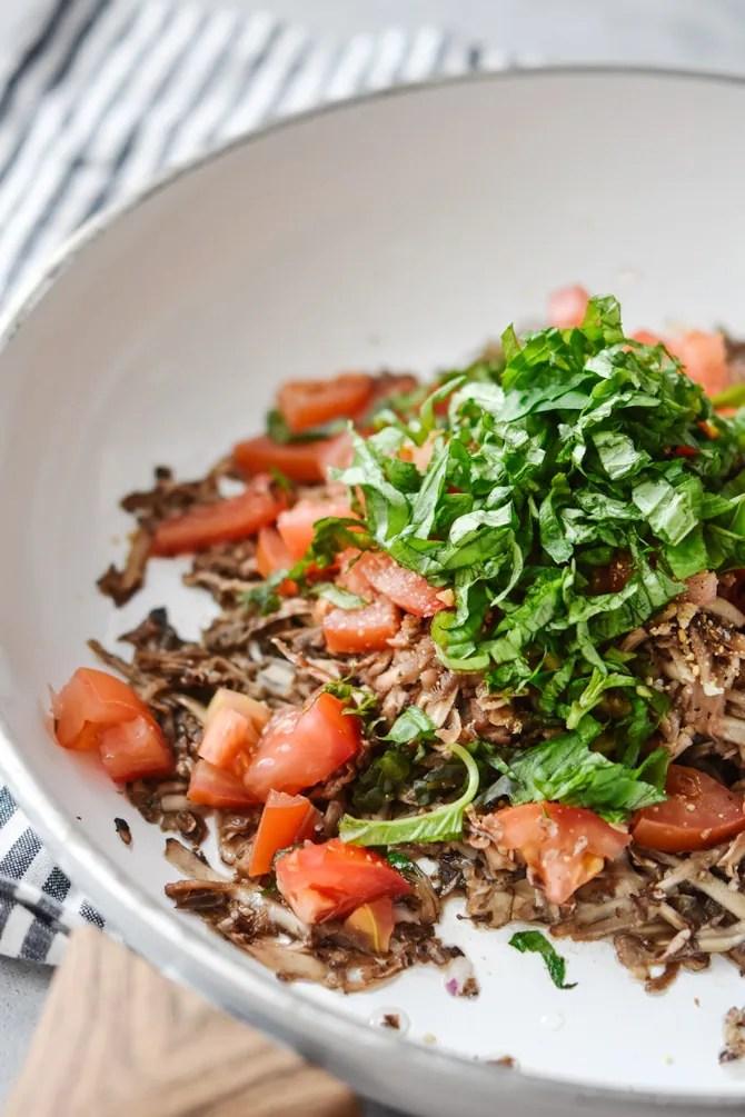 grated mushrooms in pan for quinoa scramble muffins