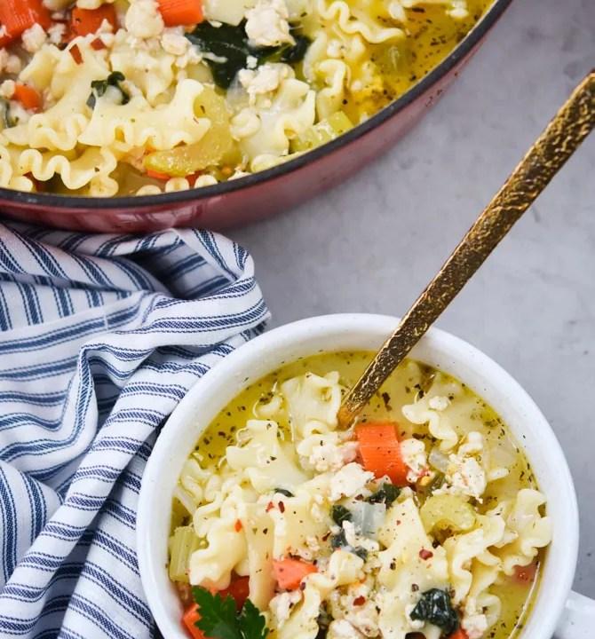 chicken lasagna soup in a bowl flatlay