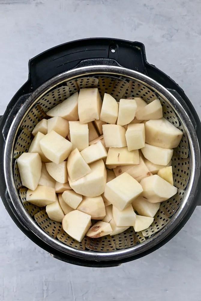 potatoes in pot in pot steamer