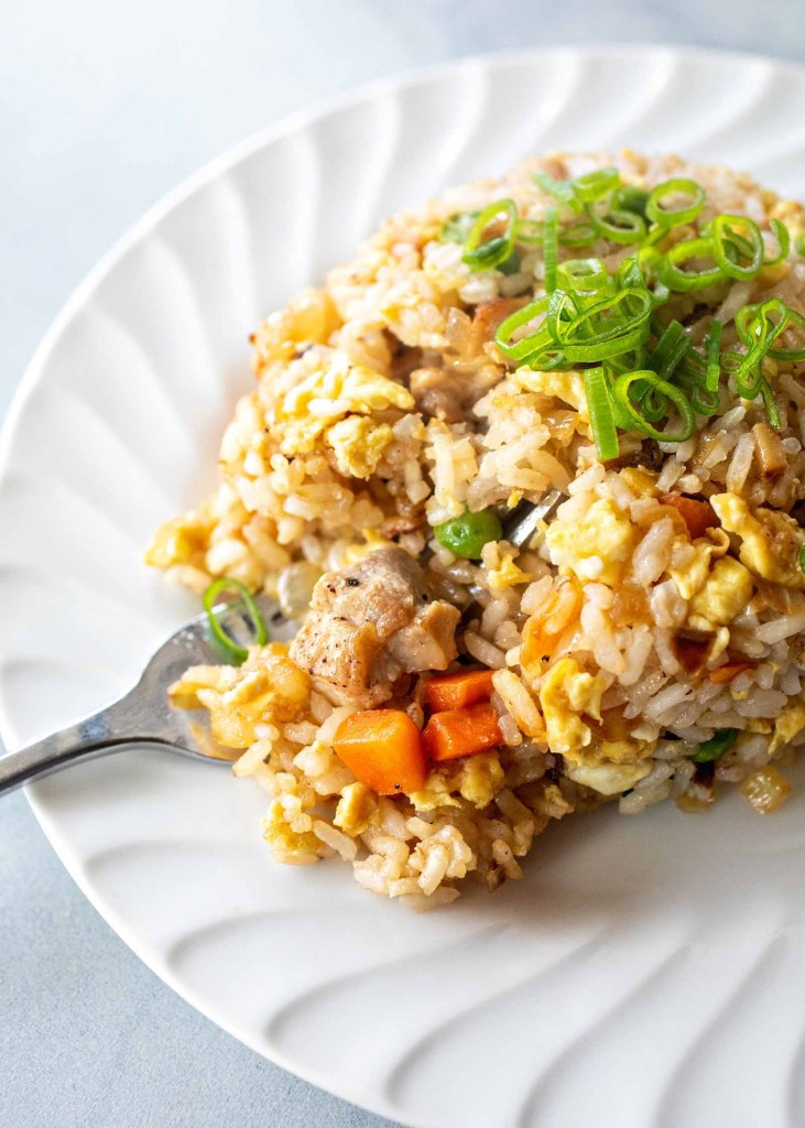 Easy pork fried rice for those that miss their Chinese takeout using these copy cat restaurant recipes. Save money plus help your family adapt more easily to a meal plan with these 20 restaurant favourite recipes.