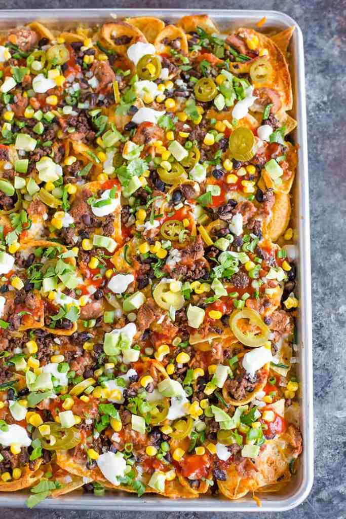 Loaded nachos recipe for those that miss their game day takeout using these copy cat restaurant recipes. Save money plus help your family adapt more easily to a meal plan with these 20 restaurant favourite recipes.