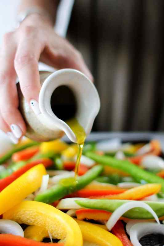 pouring oil onto vegetables