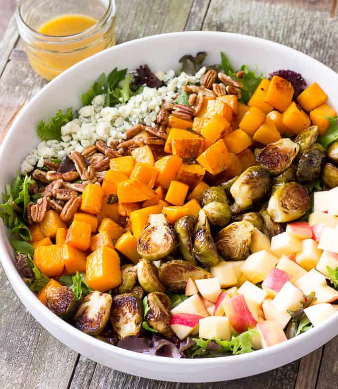 ROASTED BUTTERNUT SQUASH & BRUSSELS SPROUTS HARVEST SALAD WITH MAPLE CIDER VINAIGRETTE