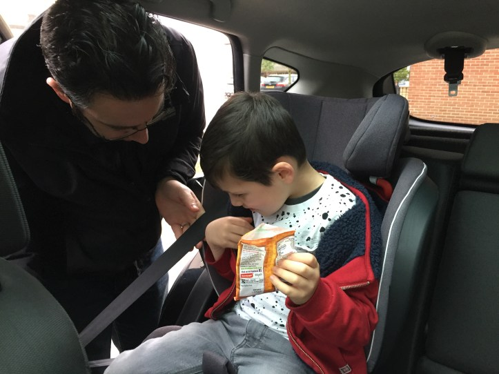 securing child in car seat booster