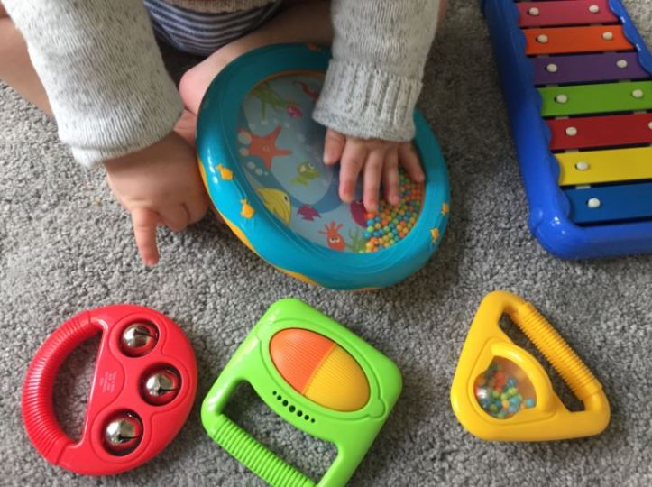 Halilit Toddler Music Orchestra - baby exploring box of musical instrument toys and ocean drum