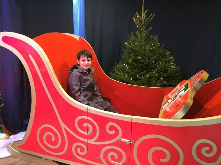 bristol zoo garden review - boy sat in sleigh