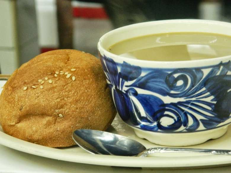 Cafe con leche with bread in the morning