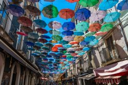 Looking up at the umbrellas above a street market in Catania Italy (Sicily)