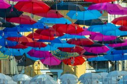 A look at colorful umbrellas hung for shade in Catania Italy (Sicily)