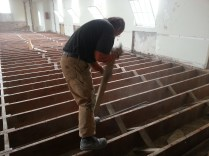 Dave pulling up floor boards.