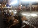 Adam rides the pony