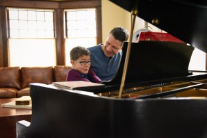 Father and son practicing the piano, Babs Mullinax, me and grace, me & grace, Fort Wayne photographer, photo gifts, lifestyle photography, family photos, ideas for family photos, indoor photography, fun family photographer, long-distance family