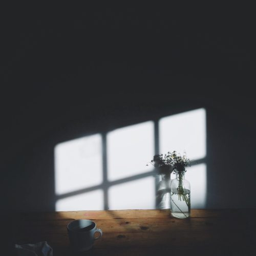 a sunlit window shadow on a wall and table